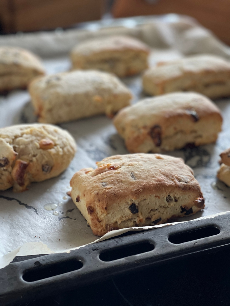 Scones on a baking tray. Steaming hot and golden.